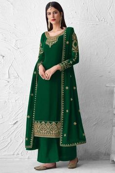 Perfectly cut, this bottle green georgette trouser suit which will make you absolutely astoundingly gorgeous and that wil be least interesting thing about you. This U-neck and full sleeve suit designed with thread and stone work. Paired with santoon palazzo pant in bottle green color with bottle green georgette dupatta. Palazzo pant is plain. #trousersuit #salwarkameez #malaysia #Indianwear #Indiandresses #andaazfashion