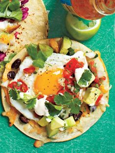 Add a fried egg to tacos for a meal high in protein, low sodium, and under 300 calories per serving! #vegetarian #taco #brunch   https://blog.myfitnesspal.com/huevos-rancheros-tacos/?utm_source=mfp&utm_medium=Pinterest