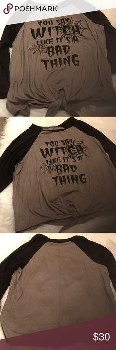 You Say Witch Like it's A BadThing Shirt-Halloween NWT 🎃You Say Witch Like it's A BadThing Shirt🎃Halloween NWT never worn. 🎃Cutest shirt ever🎃Super soft , sleepy, lightweight, comfy jersey. Has a slimming effect look in my opinion. Army green w blk writing. Ties at bottom.  It is not a short shirt. Average length. 95% rayon 5% spandex. Hand wash. Sizes xs s m l-☀️kept pet free & smoke free☀️ Atticute Tops Tees - Short Sleeve