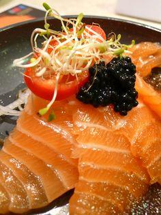 Salmon sashimi with black caviar