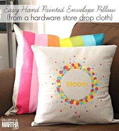 Create this easy envelope pillow cover from a canvas drop cloth that you can purchase at your local hardware store!