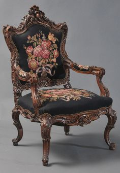 Large Rococo Style Armchair with Needlepoint Upholstery.