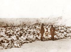 Einsatzgruppe (killing squad) members pose in front of murdered Jewish women…