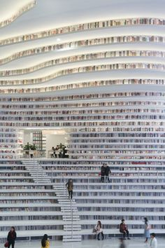 The Tianjin Binhai Library by MVRDV features terraced bookshelves that create an interior, topographical, landscape whose contours reach out and wrap around the facade.