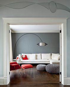 Love the pop of orange mixed with gray and white.