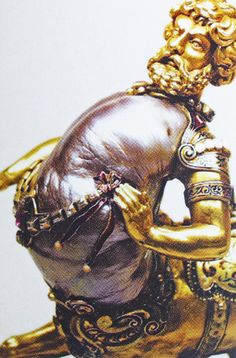 Below: Discovered in 2000, This art figurine of a Centaur was made with an 856.58 carat natural Baroque shaped pearl.