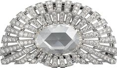 CARTIER. Brooch - rhodium-finish white gold set with 1 rose-cut oval-shaped diamond of 7.43 carats and brilliant-cut diamonds. #Cartier #L'OdyséeDeCartierParcoursD'unStyle #2013 #HauteJoaillerie #HighJewellery #FineJewelry #Diamond