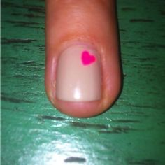Lisa Houghton's Nail- nude with hot pink heart
