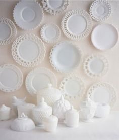 Love the display of milk glass plates on wall. This would be amazingly beautiful on a colored wall in a dining room or kitchen. You could do a fun shape with the plates as you hang them too. Vintage Dishes, Vintage Glassware, Vintage Pyrex, Antique Dishes, Vintage Bowls, Vintage Kitchenware, Antique China, Antique Glass, Antique Shops