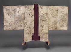 Noh costume (happi)  Jacket  Japanese, Edo period, 19th century, Noh theater jacket (happi) for high-ranking warrior role with double-width sleeves and overall repeating pattern of a hexongal tortoiseshell grid (kikkô-mon) and large leaf floral pinwheel motifs in natural ecru, reddish-orange, blue, purple, green and gilt paper discontinuous supplementary patterning wefts; purple plain-weave silk lining. MFA