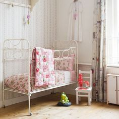 pretty bedding, but that crib is a death trap - obviously foreign