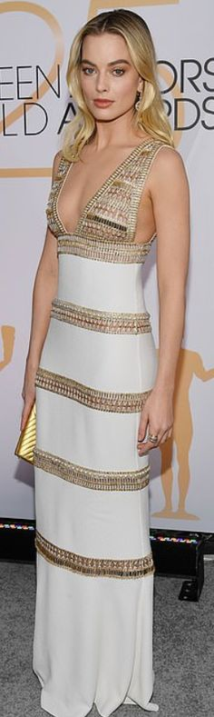 ea78ab076c3c Who made Margot Robbie s white gown and gold sandals  Dress and purse –  Chanel Shoes