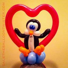 Penguin Sitting in a Heart Hairband.
