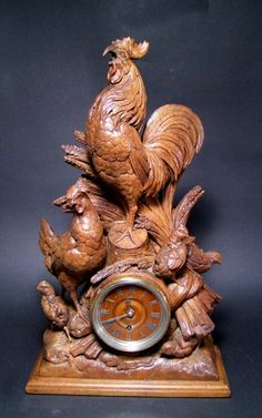 Black Forest mantle clock carved with a family of chickens, rooster, hen and three chicks in very good condition. Wood dial with applied Roman Numerals.