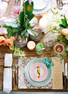 Colourful, vibrant, busy looking table layout. Perfect for a summer wedding, dinner, or party! Love the menu parchment on the right-hand side.