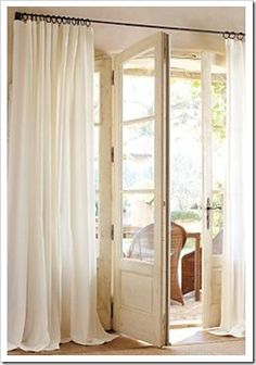 pottery barn. guess this is one area where I know my life can be simple. I have always loved just long plain white flowy curtains on plain curtain rods. So simple, so classic. For the great room
