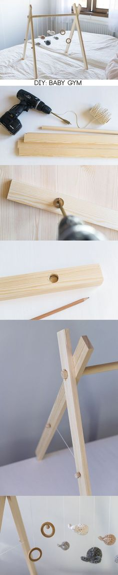 Love this wooden baby gym! Includes DIY instructions for making this toy.