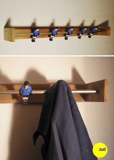 Foosball coat hooks...I absolutely love this! Now I need to go and find a broken down table so I can make this :)