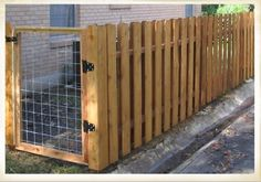 Dog run. Would go along the left side of the house, and stained dark to match house trim.