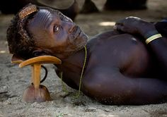 Art Propelled: HAND HELD African headrests are carved out of a single piece of wood to the correct height and size to fit the user's head. The headrest should keep the head off the ground and keep the hair-do from being mussed.