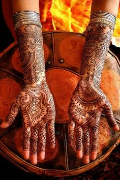 "ॐ Mehndi, India. Mehndi is a Hindu symbolic representation of the outer and the inner sun. Hinduism customs are centred around the notion of ""awakening the inner light/soul."" These Hindu designs originated in ancient India in 3500BC as a Hindu art form, and was adopted by the Middle East where they call it Henna. ॐ"