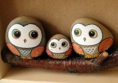A hand-painted stones painted owl