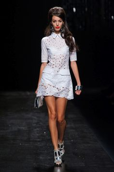 I like this top - it's got a bit of racy and  a bit of modest at the same time   --Moschino Spring 2013