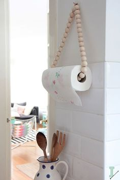 DIY: paper towel holder by IDA interior lifestyle.   I love the informality of this