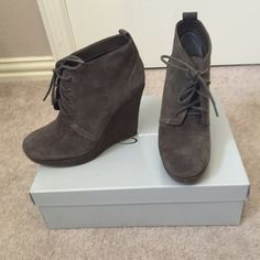 Jessica Simpson wedge lace up booties Jessica Simpson gray wedge lace up booties. Super cute and comfy. Suede. Worn a few times. Comes with box. Jessica Simpson Shoes Ankle Boots & Booties