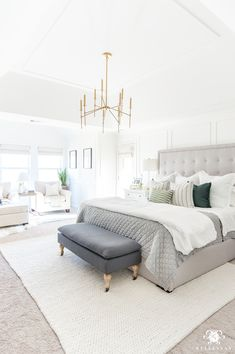 White Master Bedroom Design Ideas with Brass Light and Gray Tufted Bed