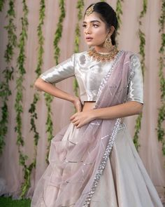Stunning designer lehenga and silver blouse with lavender color net dupatta. 06 February 2019 WhatsApp us for more details : Lengha Blouse Designs, Half Saree Designs, Lehenga Designs Latest, Half Saree Lehenga, Lehnga Dress, Lehenga Gown, Lengha Choli, Sarees, Indian Designer Outfits