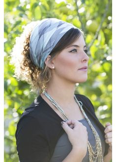 Triangular, turquoise and gray checkered head covering. Perfect for every day wear!