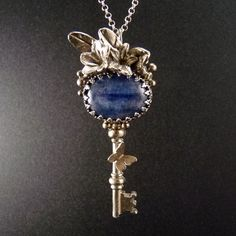 Beautiful key pendant covered in flowers and butterflies.