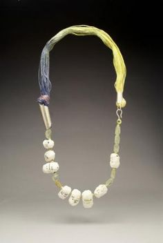 Lydia Buxton, Swathed, 2011, linen threads, keraflex porecelain, sterling silver, prenite beads, lewisonite beads, 40 x 20 cm