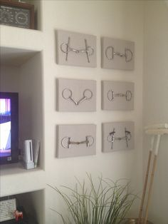 Take the equestrial look to your walls with a simple display of bits of fabric covered canvasses.
