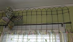 Some very cool decorating ideas on this site.  I love this for over a window.