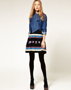 i'd pair the skirt with a soft, lighter & more relaxed denim top. love it!
