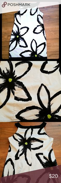 Sleeveless dress Form fitting white dress with black collar and black banding. The dress has black and lime green flowers. This dress is cotton and spandex. In great condition. Worn only once. London Times Dresses