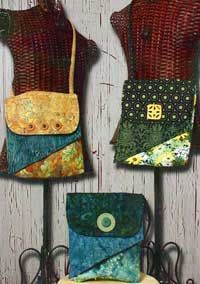 Made with fat quarters, cross body bag with hidden pocket, pattern $8.00. Really cute bags!
