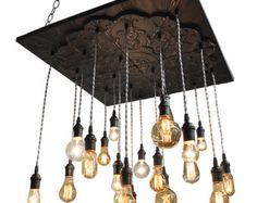 Urban Chandelier - Industrial style lighting This beautiful Urban Bare Bulb 12 Pendant Chandelier with frame has satin sockets and twisted black cord. You can choose your base color from the chart pictured above (shown here in Bleached Grey) ***PLEASE NOTE YOUR BASE COLOR CHOICE.  DETAILS: Base: 12 x 34 with 2 recessed matching wood frame Base Color: Bleached Grey Options - See chart Cord: Twisted Black Rayon Pendants: 12 sockets with combination switches for a more industrial feel…