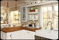 I love the neutral white on white breezy cottage feeling in this kitchen.  Behr's Cottage White on the walls.