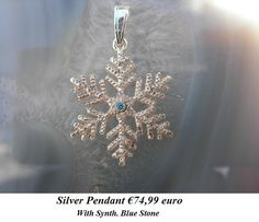 Silver snowflake blue stone