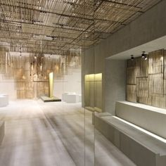 Handcrafted woven bamboo screens are suspended in sections to cover the ceiling and walls of this Isabel Marant boutique in Bangkok by Parisian studio Ciguë. Isabel Marant, Commercial Design, Commercial Interiors, Bamboo House Design, Architecture Design, Bamboo Architecture, Bamboo Screening, Design Furniture, Concrete Floors