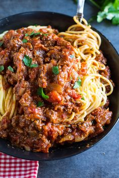 Spiced Spaghetti Sauce - Chili powder, nutmeg, cinnamon, sage, a bay leaf, allspice, oregano, and red pepper flakes all simmer together for 90 minutes along with some ground beef and ground pork to make an extra thick and fully flavored meat sauce.