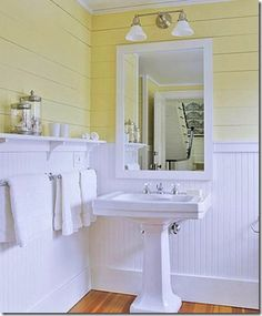 Love beadboard in a bathroom. This one is especially cheerful, and the painted, horizontal boards are great.