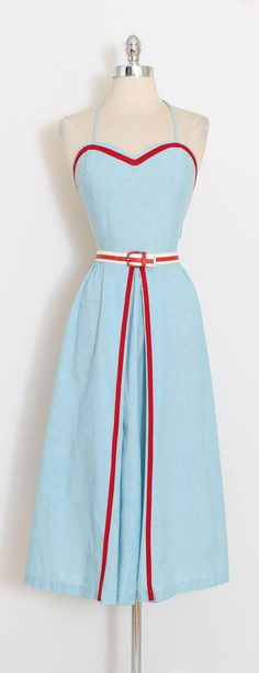 ➳ vintage 1940s dress and jacket  * darling sky blue cotton with red accents * halter with tie behind neck * metal side zipper * button details back * matching jacket * comes with belt condition | excellent - one tiny flaw in the fabric at front of left jacket sleeve.  fits like medium  length 47 bodice length 17 bust 36-38 waist 28-29  ➳ shop http://www.etsy.com/shop/millstreetvintage?ref=si_shop  ➳ shop policies http://www.etsy.com/shop/millstree...