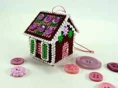 Needlepoint Gingerbread House Ornament on plastic canvas. Tiny shutters and everything. #craftypod
