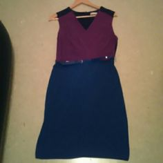 """Calvin Klein Color block dress size 4 Measurements: approx. 34"""" bust, 38"""" length, 25"""" waist. Fabric: shell: 95% polyester, 5% spandex.  Cute color block dress in fuchsia in the front, black upper back and blue solid bottom. V neck and faux wrap style. Back zip closure. Belted. Some minor scuffing/wear on the belt, but other than that, the dress is in very good condition.  Comes from a non smoking, pet free home. Calvin Klein Dresses"""
