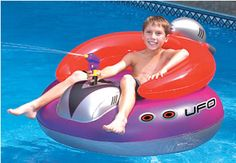 "UFO Spaceship With Squirt Gun- Retro styling makes this inflatable ride-on swimming pool toy really cool with kids. It comes equipped with its own ray gun (squirt gun) which makes this rideable out-of- this world. Made of heavy gauge vinyl the UFO measures 45"" across. $38 FREE SHIPPING"
