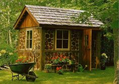 This wee pic is of a sweet garden house in the United Kingdom. So quaint & charming. Why can't mine look like this?...........